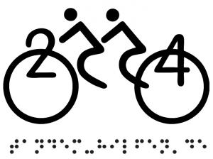 Das Tandem-Hilfen-Logo auf den T-Shirts der Mitfahrenden